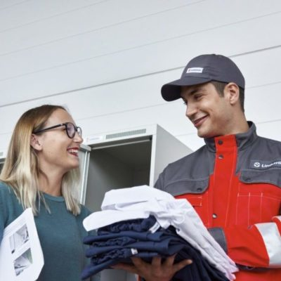 Lindstrom worker delivering rented uniforms